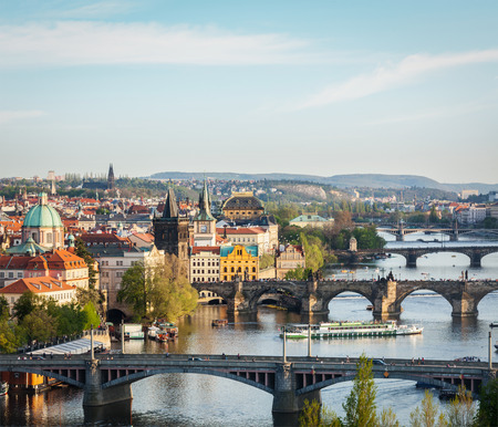 Travel Prague concept background - elevated view of bridges over Vltava river from Letná Park. Prague, Czech Republic photo