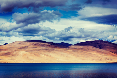 wetland conservation: Vintage retro effect filtered hipster style travel image of Himalayan mountain lake in Himalayas Tso Moriri (official name: Tsomoriri Wetland Conservation Reserve), Korzok,  Changthang area, Ladakh, Jammu and Kashmir, India Stock Photo