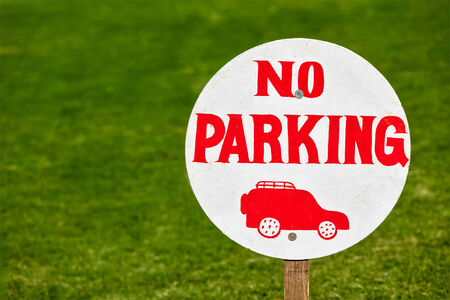 no parking: No parking sign on green lawn Stock Photo