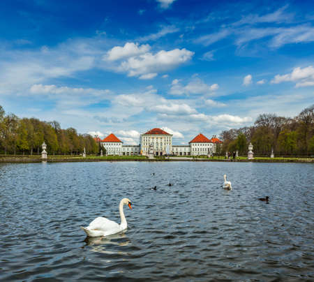 nymphenburg palace: Swan in fountain in Grand Parterre (Baroque garden) and the rear view of the Nymphenburg Palace. Munich, Bavaria, Germany