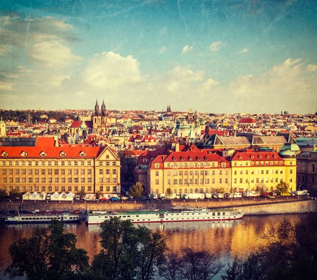tynsky church: Vintage retro hipster style travel image of aerial view of Prague and Vltava river on sunset, Czech Republic with grunge texture overlaid Stock Photo