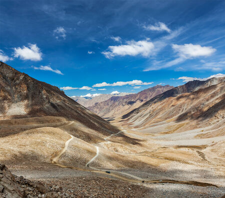 Himalayan valley landscape with road near Kunzum La pass - allegedly the highest motorable pass in the world (5602 m), Ladakh, India