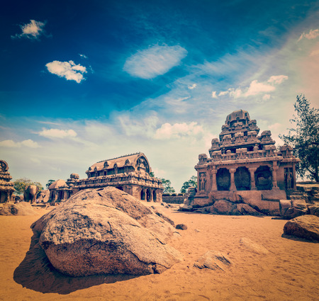 mamallapuram: Vintage retro hipster style travel image of Five Rathas - ancient Hindu monolithic Indian rock-cut architecture. Mahabalipuram, Tamil Nadu, South India Stock Photo