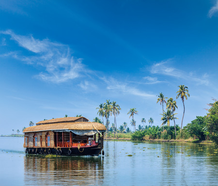 backwaters: Travel tourism Kerala background - houseboat on Kerala backwaters. Kerala, India Stock Photo