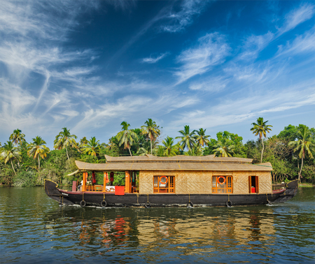houseboat: Travel tourism Kerala background - houseboat on Kerala backwaters. Kerala, India Stock Photo