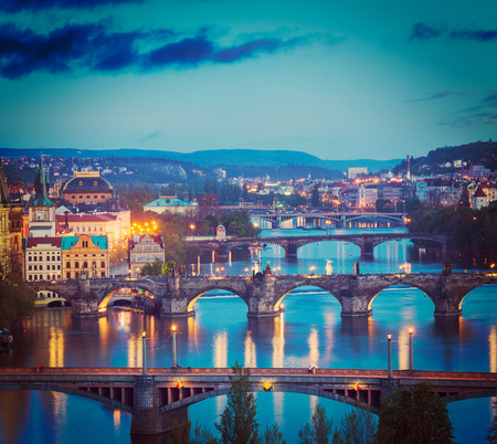 czechoslovakia: Vintage retro hipster style travel image of travel Prague concept background - elevated view of bridges over Vltava river from Letná Park. Prague, Czech Republic in twilight
