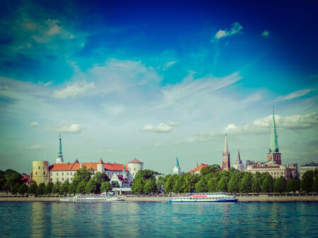 st jamess: Vintage retro hipster style travel image of  Riga over Daugava river: Riga Castle, St. Jamess Cathedral, St. Peters Church. Riga, Latvia Stock Photo