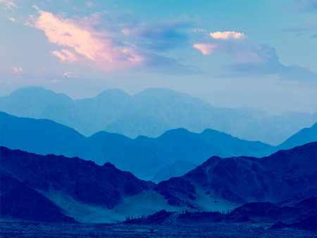 himalayas: Vintage retro effect filtered hipster style travel image of Himalayas mountains in twilight. Ladakh, Jammu and Kashmir, India