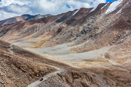 allegedly: Himalayan valley landscape with road near Kunzum La pass - allegedly the highest motorable pass in the world (5602 m), Ladakh, India