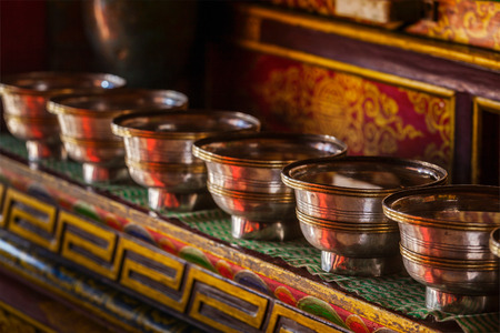 gompa: Offerings (Tibetan Water Offering Bowls)  in Lamayuru gompa (Tibetan Buddhist monastery). Ladadkh, India