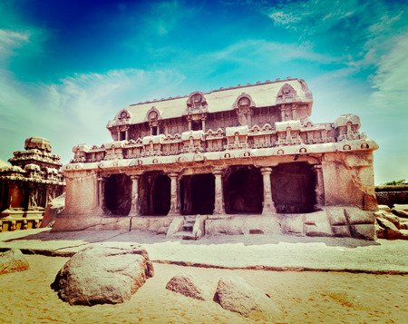 pallava: Vintage retro hipster style travel image of Five Rathas - ancient Hindu monolithic Indian rock-cut architecture. Mahabalipuram, Tamil Nadu, South India Stock Photo