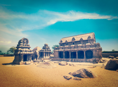south india: Vintage retro hipster style travel image of Five Rathas - ancient Hindu monolithic Indian rock-cut architecture. Mahabalipuram, Tamil Nadu, South India Stock Photo