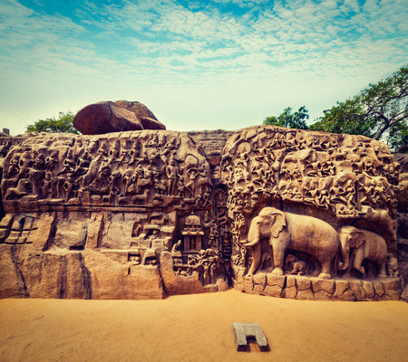 pallava: Vintage retro hipster style travel image of Descent of the Ganges and Arjunas Penance ancient stone sculpture - monument at Mahabalipuram, Tamil Nadu, India Stock Photo