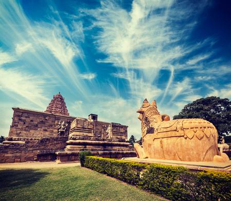 nandi: Vintage retro hipster style travel image of Hindu temple Gangai Konda Cholapuram with giant statue of bull Nandi. Tamil Nadu, India