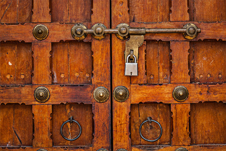 Latch with padlock on door in India photo