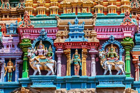 parvati: Shiva and Parvati on bull images. Sculptures on Hindu temple gopura (tower). Menakshi Temple, Madurai, Tamil Nadu, India