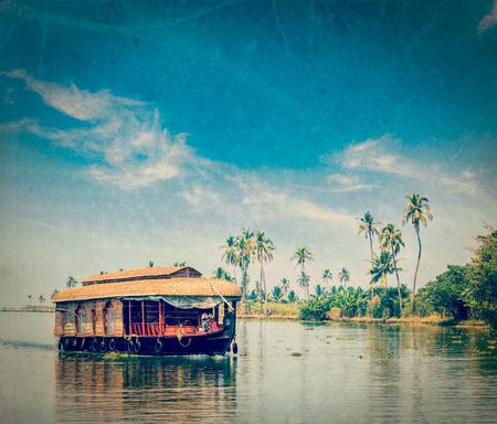 houseboat: Vintage retro hipster style travel image of travel tourism Kerala background - houseboat on Kerala backwaters with grunge texture overlaid. Kerala, India Stock Photo