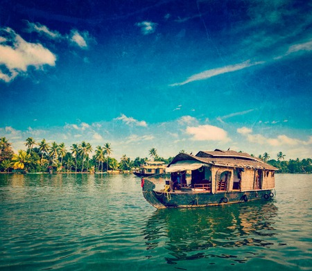 houseboat: Vintage retro hipster style travel image of travel tourism Kerala background - houseboat on Kerala backwaters with grunge texture overlaid. Kerala, India Editorial