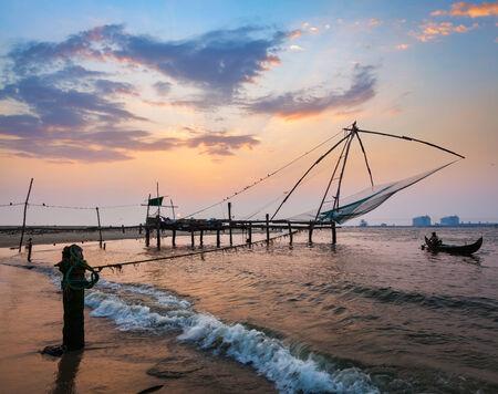 india fisherman: Kochi chinese fishnets on sunset. Fort Kochin, Kochi, Kerala, India
