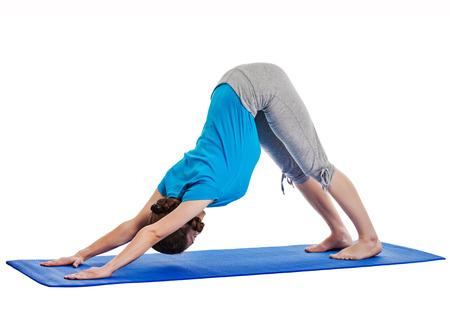 Yoga - young beautiful woman yoga instructor doing Downward Facing Dog (adho mukha svanasana) asana exercise isolated on white background photo
