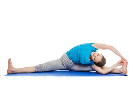 parivrtta: Yoga - young beautiful slender woman yoga instructor doing Revolved Wide Seated Forward Bend Pose (parivrtta upavistha konasana) asana exercise isolated on white background