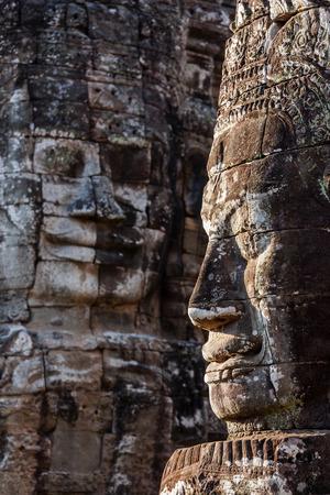 bayon: Ancient stone faces of Bayon temple, Angkor, Cambodia