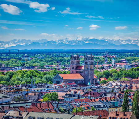 Aerial view of Munich with Bavarian Alps in background, Bavaria, Germany Фото со стока