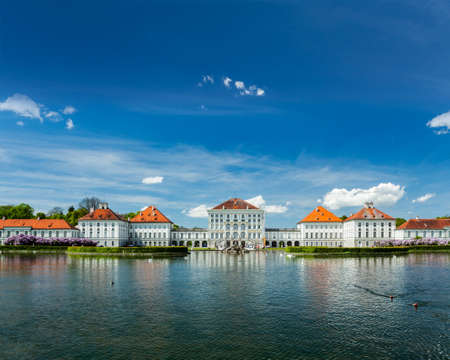 schloss: Artificial pool in front of the Nymphenburg Palace. Munich, Bavaria, Germany Stock Photo