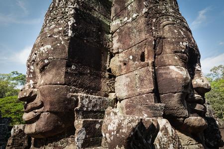 Ancient stone faces of Bayon temple, Angkor, Cambodia photo