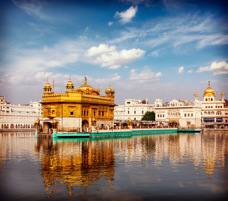 Vintage retro effect filtered hipster style travel image of Sikh gurdwara Golden Temple (Harmandir Sahib). Amritsar, Punjab, India Stock Photo