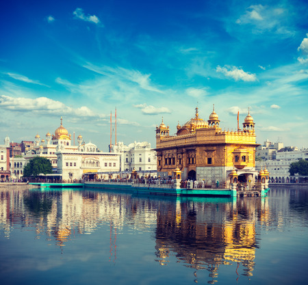 temple tank: Vintage retro effect filtered hipster style travel image of Sikh gurdwara Golden Temple (Harmandir Sahib). Amritsar, Punjab, India Stock Photo