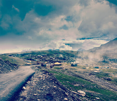 himachal pradesh: Vintage retro effect filtered hipster style travel image of Road in Himalayas on top of  Rohtang La pass, Himachal Pradesh, India Stock Photo