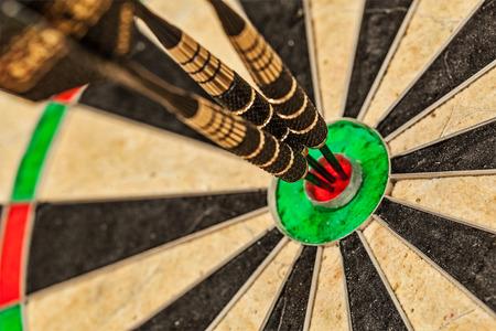focus shot: Three darts in bulls eye close up Stock Photo