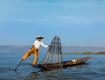 inle: Traditional Burmese fisherman at Inle lake