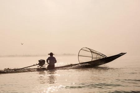 Traditional Burmese fisherman at Inle lake photo