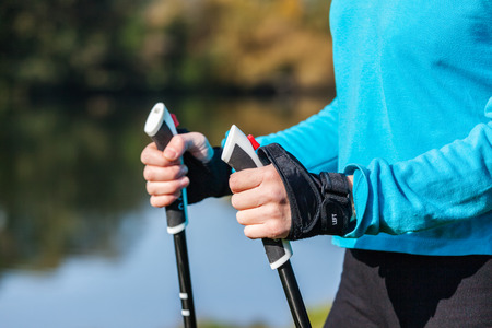 walking pole: Closeup of womans hand with nordic walking poles
