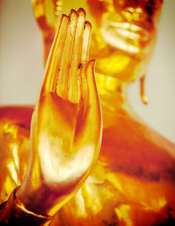 Vintage retro effect filtered hipster style travel image of Buddha golden statue blessing hand, Wat Pho, Bangkok,  Thailand. Low point of view photo