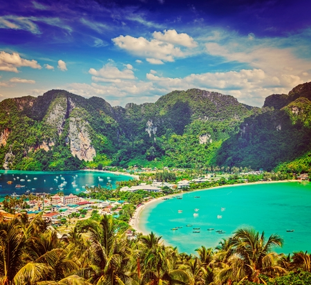 Phi: Vintage retro hipster style travel image of Travel vacation background - Tropical island with resorts - Phi-Phi island, Krabi Province, Thailand Stock Photo