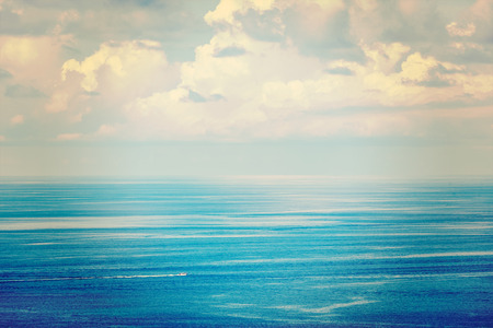 Speeding boat in sea photo