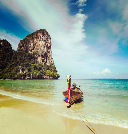 Long tail boat on beach, Thailand photo