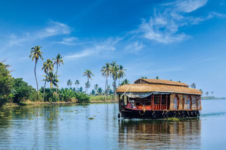 Travel tourism Kerala background - houseboat on Kerala backwaters. Kerala, India Stock Photo