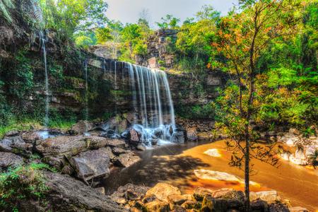 High dynamic range HDR image of tropical waterfall. Popokvil Waterfall, Bokor National Park, Cambodia Reklamní fotografie