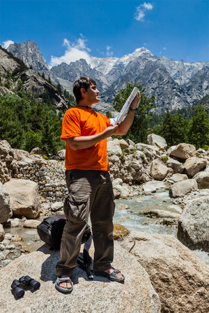 Hiker with map photo