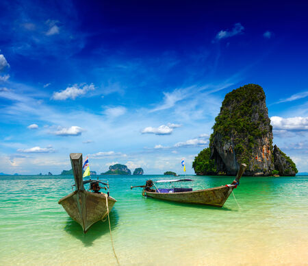 Long tail boats on beach, Thailand photo