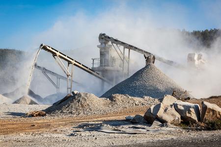 sand quarry: Industrial crusher - rock stone crushing machine Stock Photo