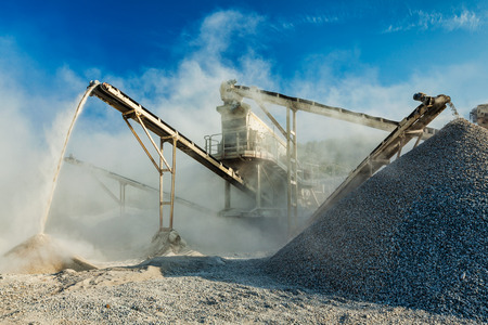 sand quarry: Industrial crusher - rock stone crushing machine Stock Photo
