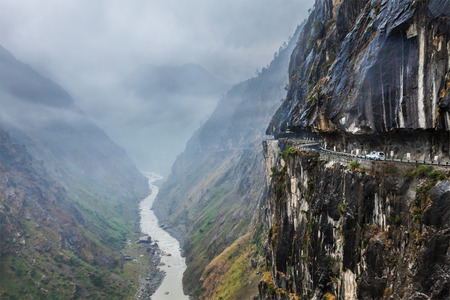 ravine: Car on road in Himalayas