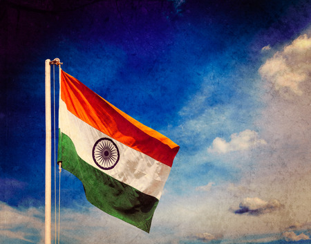 Vintage retro effect filtered hipster style image of India indian flag against blue sky with copyspace Stock Photo