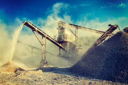 gravel pit: Vintage retro effect filtered hipster style image of Industrial background - crusher rock stone crushing machine at open pit mining and processing plant for crushed stone, sand and gravel