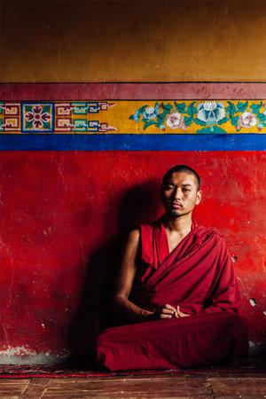 gelugpa: DISKIT, INDIA - SEPTEMBER 12, 2012: Unidentified Tibetan Buddhist monk in Diskit gompa on September 12, 2012 in Diskit, India. Diskit gompa is the oldest and largest Buddhist monastery (gompa) in the Nubra Valley of Ladakh, India
